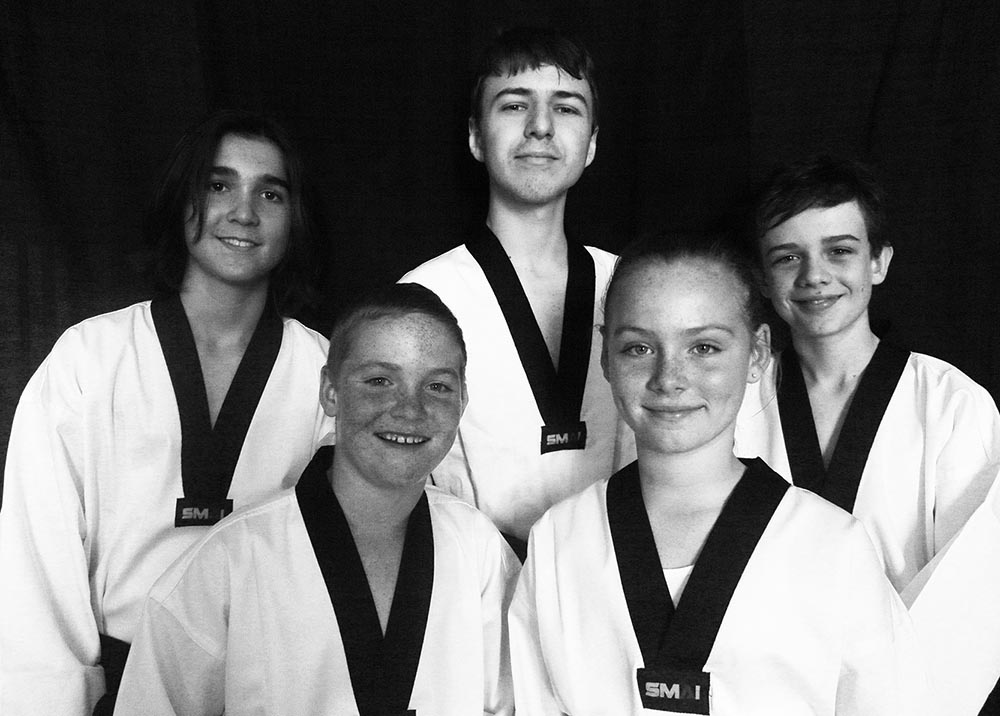 Our five new black belts join the family!